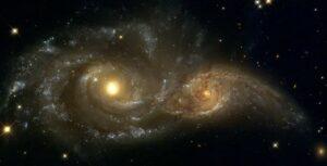 NGC 2207 en IC 2163 in Canis Majoris