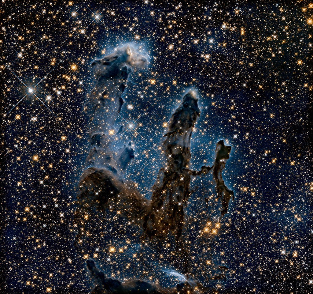 "De ""Pillars of Creation"" in infrarood licht. Credit: NASA, ESA/Hubble and the Hubble Heritage Team)"